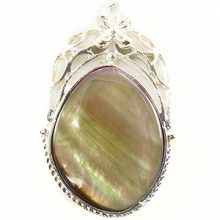 Silver finish metal framed pendant with brownlip shell