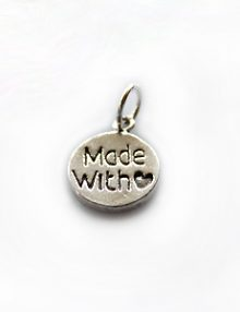 Thai silver charm made with love engraved